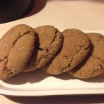 side view of some molasses cookies from cocos confections